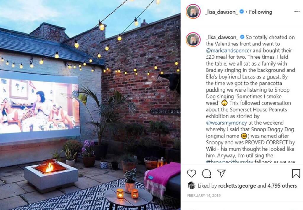 lisa dawson garden with screen, garden rugs and festoon lights