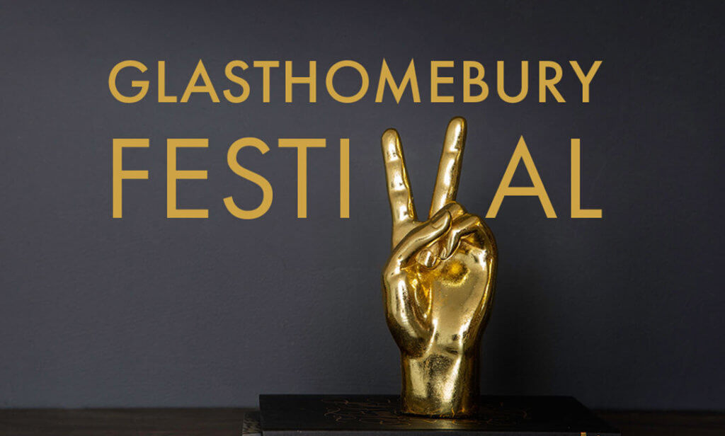 image of the gold peace hand ornament with the words 'Glasthomebury Festival'.