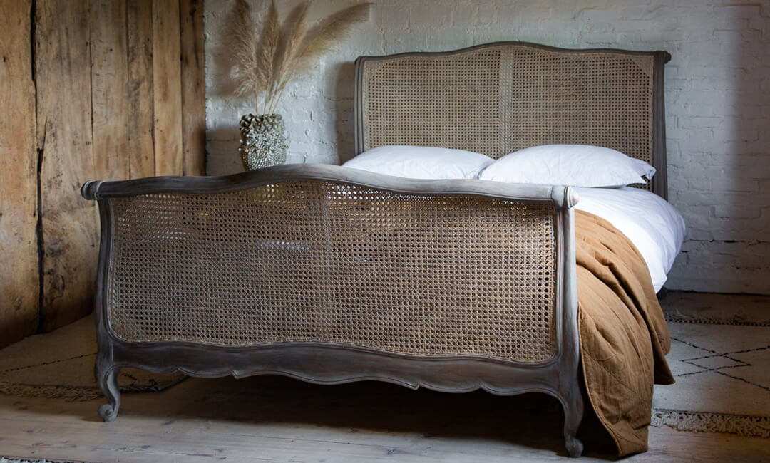lifestyle image of roll top rattan bed