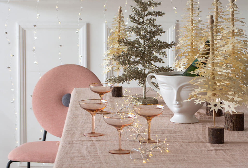 Metallic accessories on a Christmas table setting