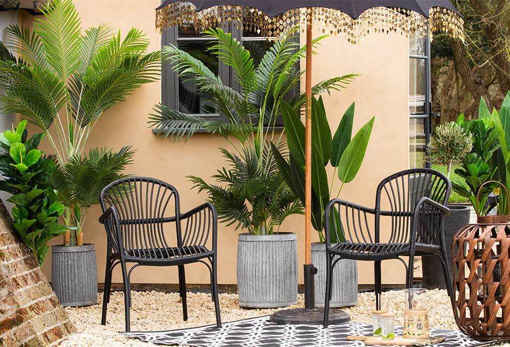 summer garden setup with chairs and umbrella