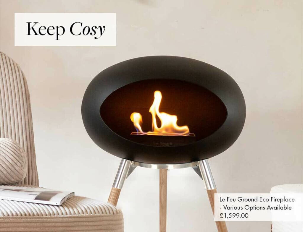 Image of the black eco fireplace with silver metal and wood legs. Text reads: Keep Cosy.