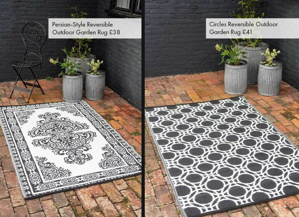 Image of 2 garden rugs in black and white in a outdoor courtyard setting.
