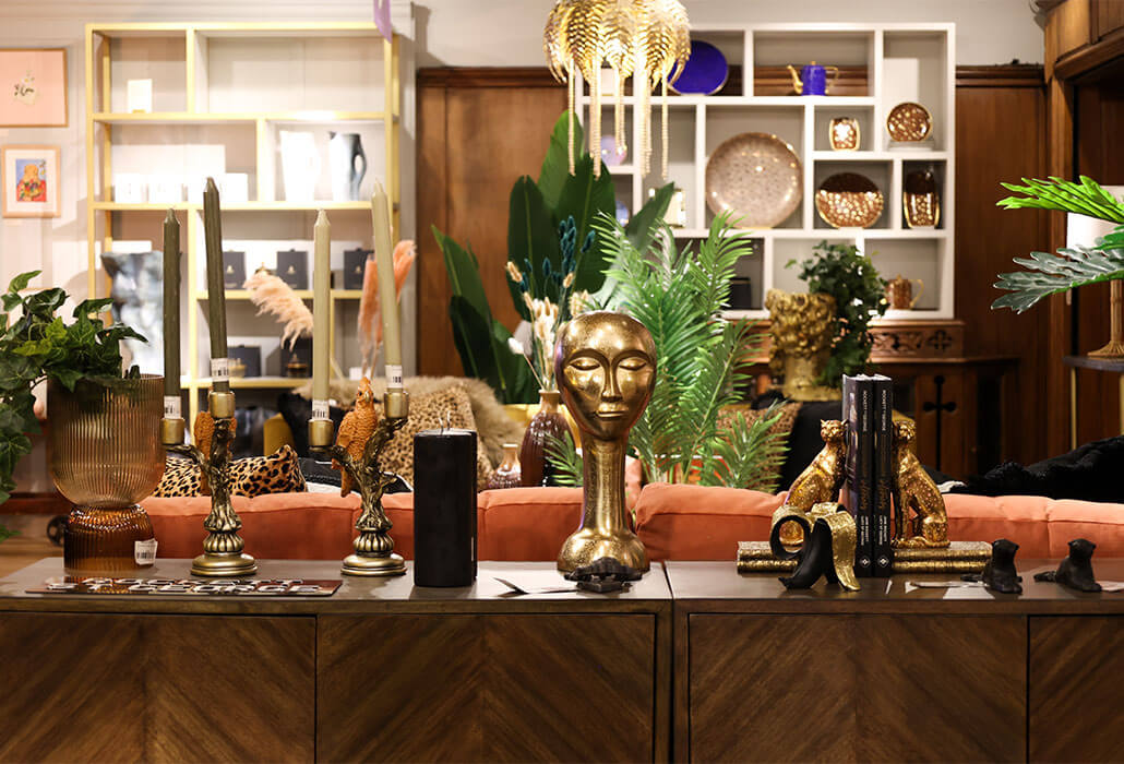 image of a parquet sideboard adorned with decorative accessories such as an amber tea light, cockatoo candle holder and leopard bookends