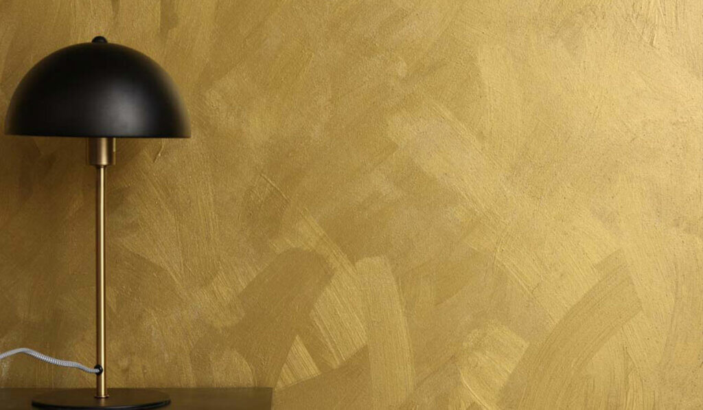 image of metallic effect paint with visable brush strokes in antique gold